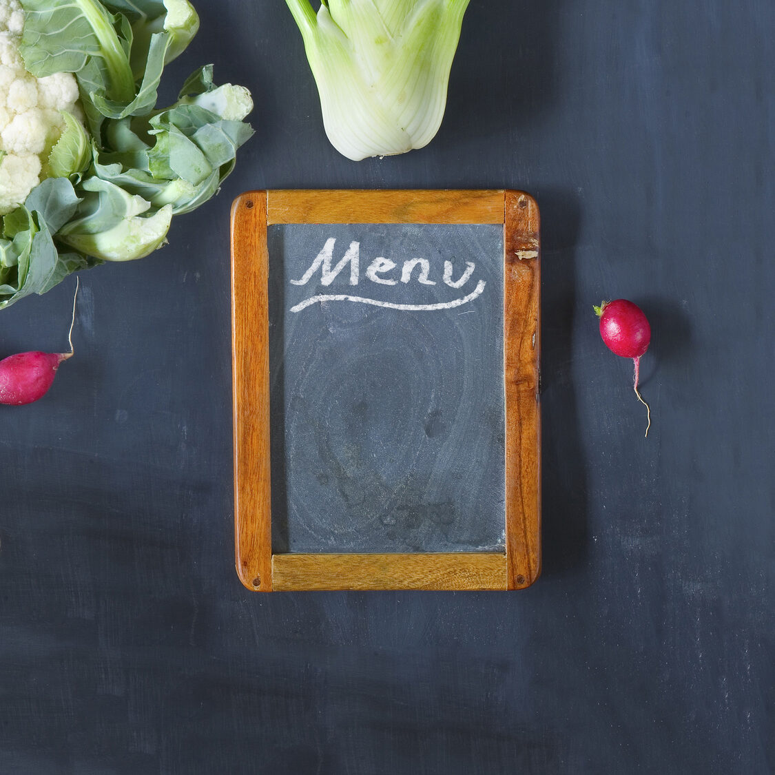 Reataurant menu template with vegetables and empty black board, flat lay